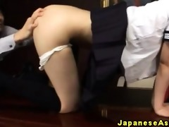 oriental schoolgirl receives a toy in her arse