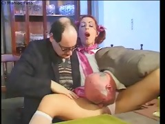 redhead group-fucked on a table