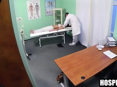 brunette patient getting massaged by her doctor